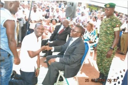 Buganda Premier Charles Peter Mayiga greeting Hon Kivumbi Earnest Benjamin
