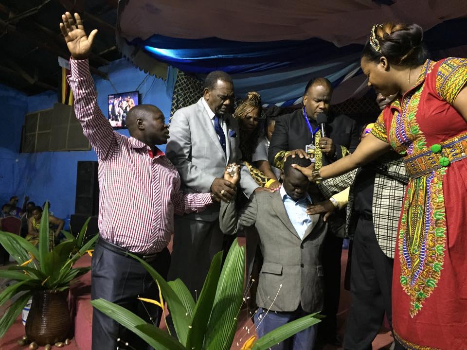 International Pastors praying for Kivumbi