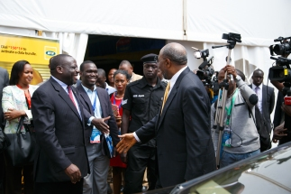 Rt Hon Ruhakana Rugunda moves to shake hands with Hon Kivumbi Earnest Benjamin before Journalists and International Government Figures