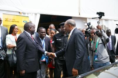 Rt Hon Ruhakana Rugunda shakes Hon Kivumbi Earnest Benjamin before Journalists and International Government Figures