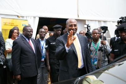 Rt Hon Dr Ruhakana Rugundawaves at Delegates alongside Kivumbi Earnest Benjamin, Journalists and International Government Figures