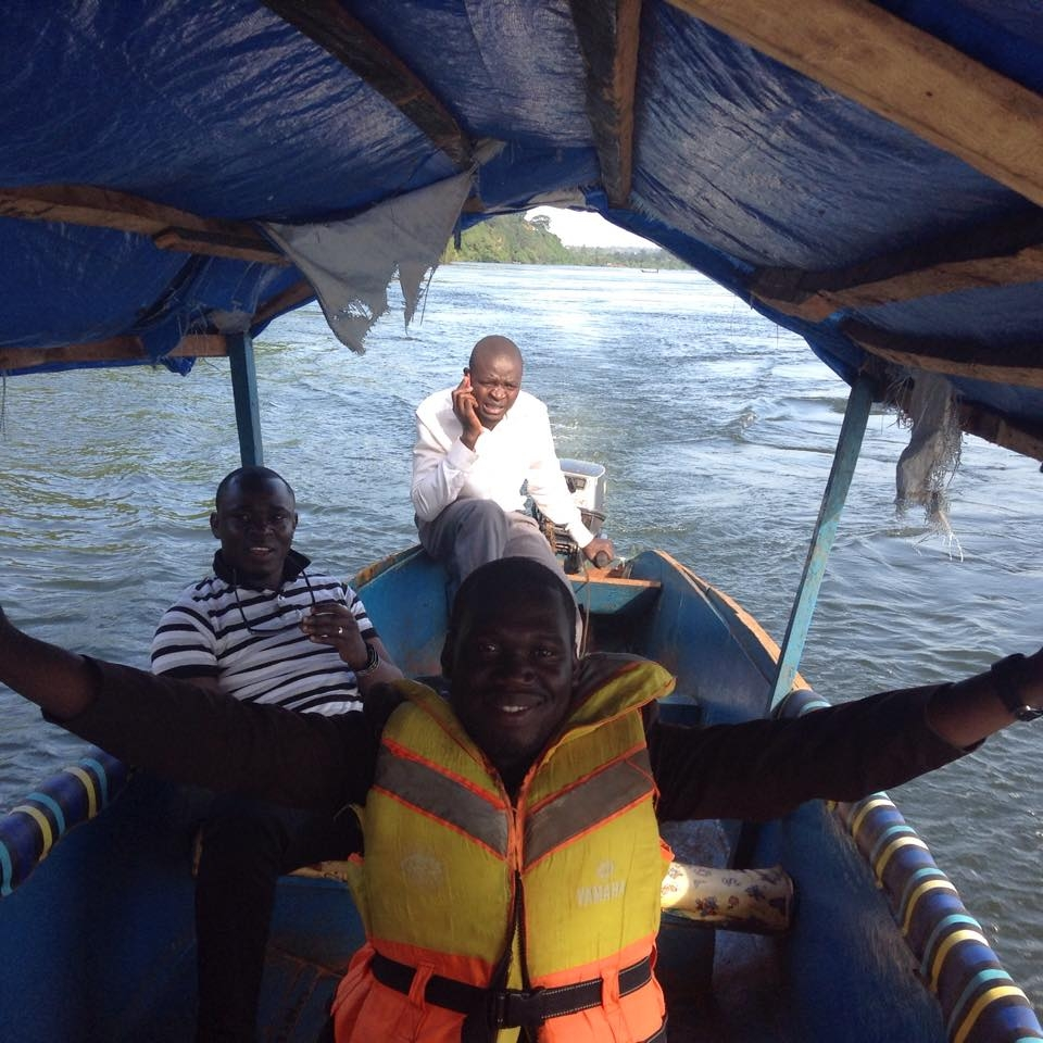 Hon Kivumbi Earnest Benjamin in a life jacket, Ps Bweyinda David and unknown sailor on a boat ride at the Source of River Nile in Jinja