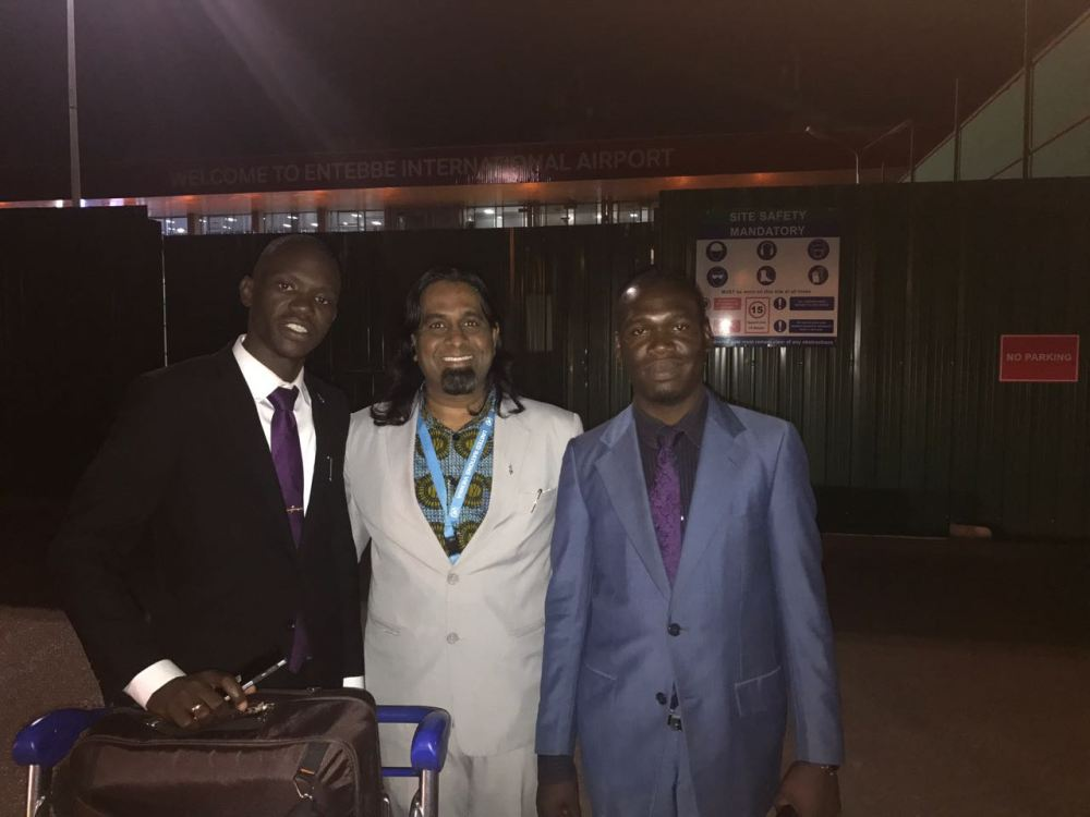 Kivumbi Earnest Bnejamin & Don Vicent Bwana recieve DR. APOSTLE PAUL KARL VICTOR SR (7)
