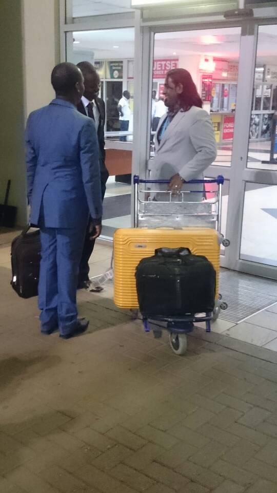 Kivumbi Earnest Bnejamin & Don Vicent Bwana recieve DR. APOSTLE PAUL KARL VICTOR SR (8)