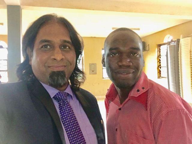 Kivumbi Earnest Benjamin with Dr Paul Victor