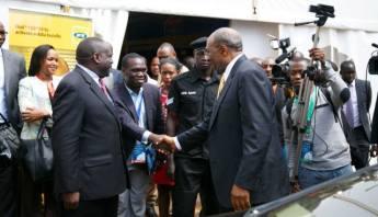 Kivumbi Earnest Benjamin with Prime Minister Dr Ruhaka Rugunda (1)